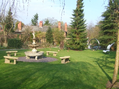 The Fountain Lawn with The Storytellers chair and  Richard's and Dave's Garden Visible in the background